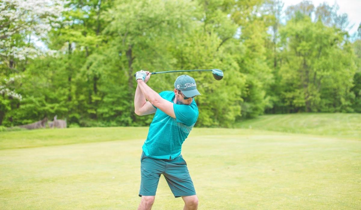 Golfer hitting drive - 5 Golf Tips for Beginners